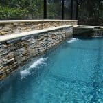 Outdoor waterfall into a pool
