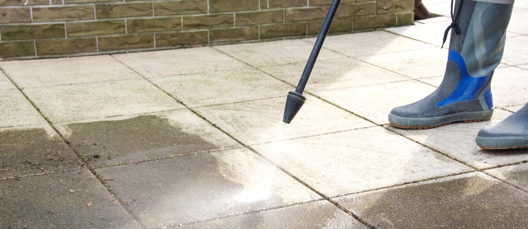 Cleaning an outdoor patio with a pressure washer