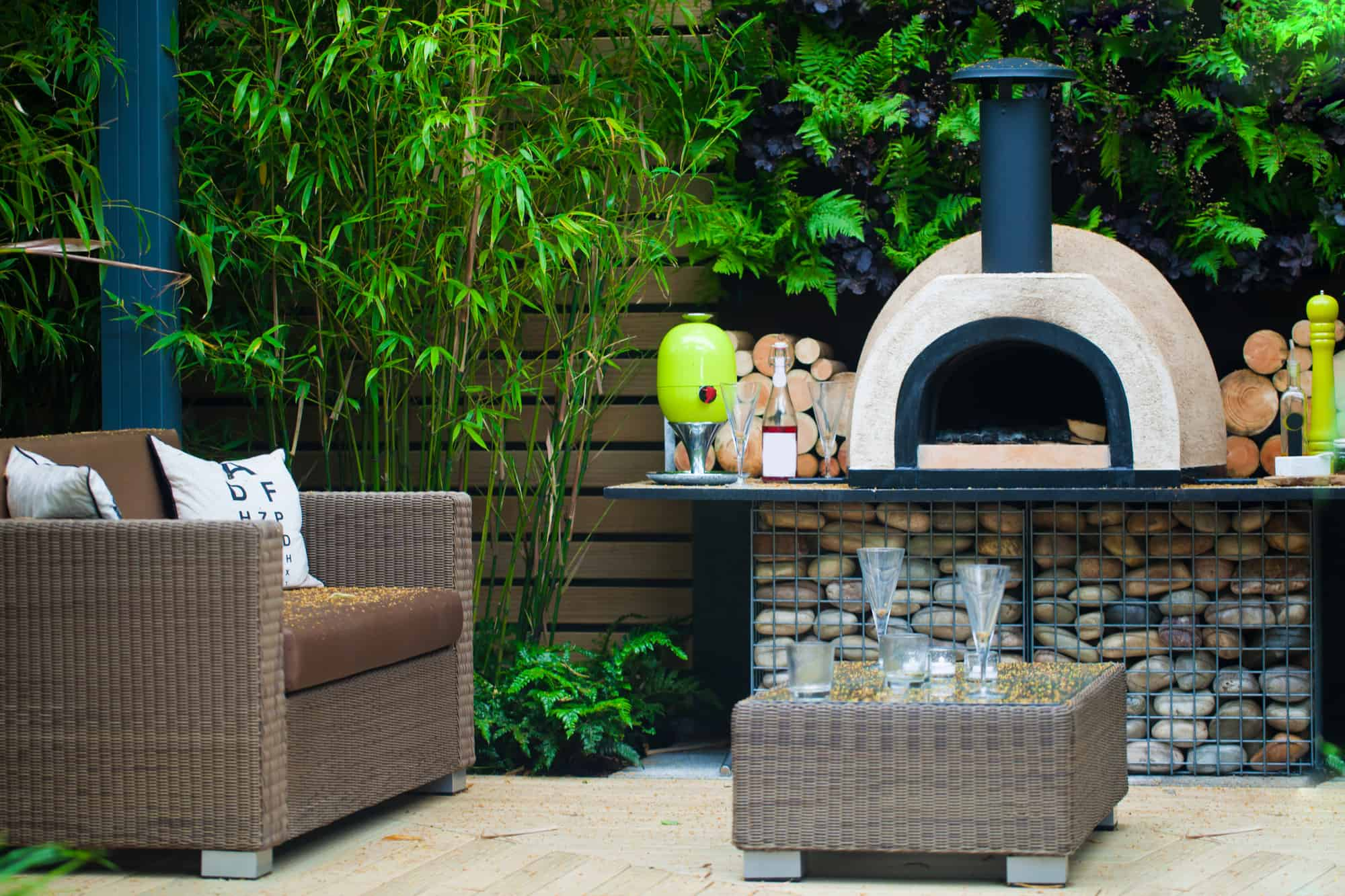 Pizza oven in backyard lounge space